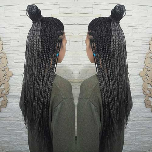 A Half Top Knot With Braids