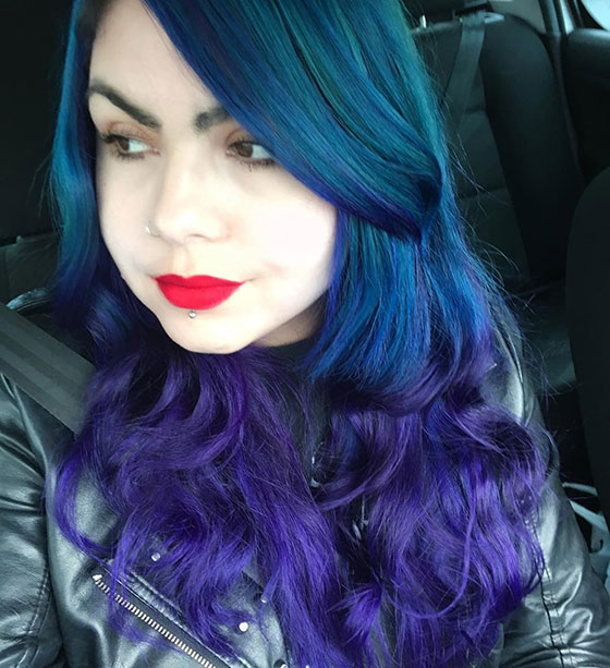 Bouncy Blue And Purple Curls With Side Swept Bangs