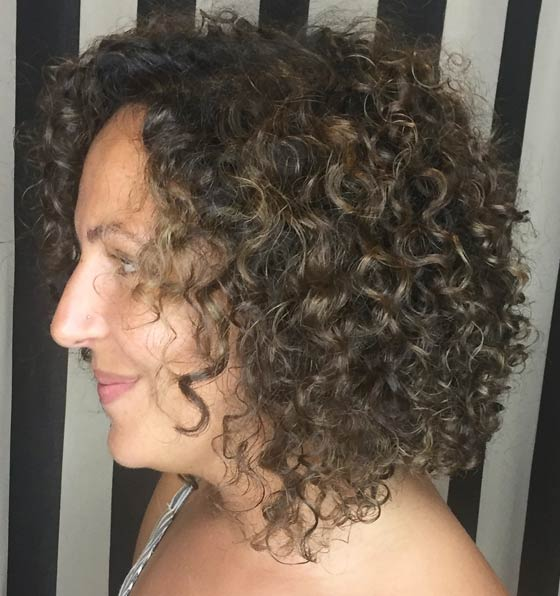 Kinky Curls With Subtle Highlights