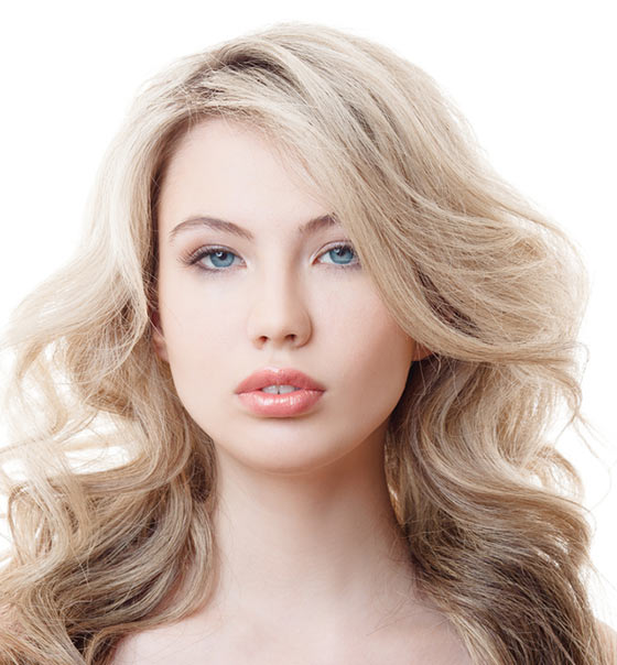 Long Blond Waves With Side Swept Bangs