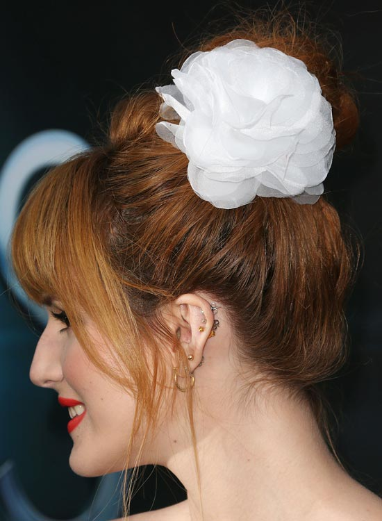 Messy High Bun With Puffy Top and Fringes